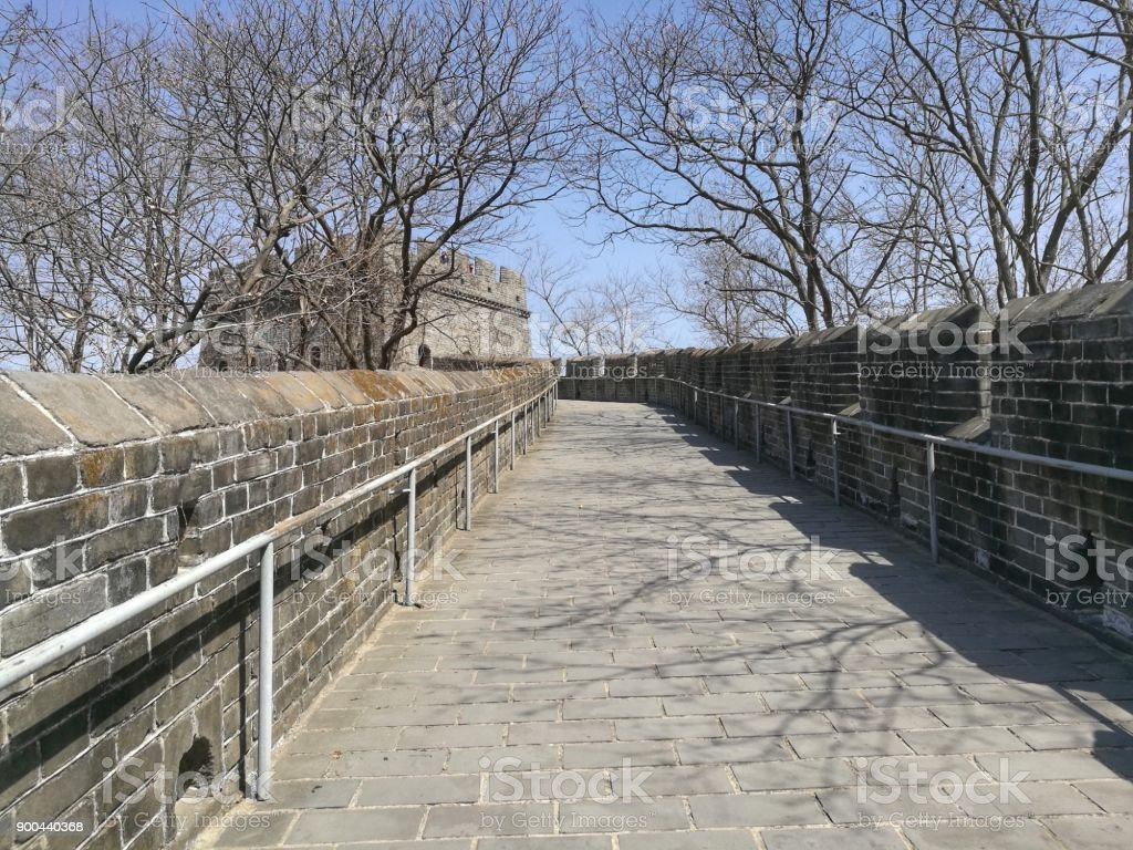 China Great Wall with trees in autumn and their shadows on pavement. stock photo