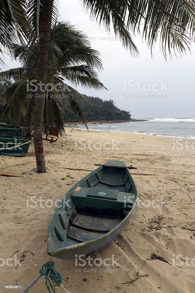 China, Hainan Island, fishing boat on beach. stock photo