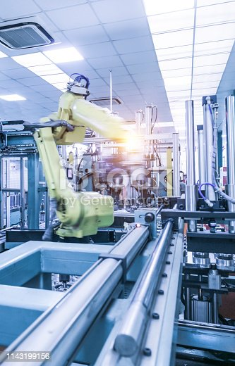 istock China high tech factory, Industry4.0.Assembly robot represent the movement. In the automotive parts industry. 1143199156