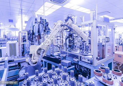 istock China high tech factory, Industry4.0.Assembly robot represent the movement. In the automotive parts industry. 1143199161