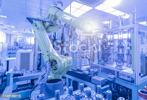 istock China high tech factory, Industry4.0.Assembly robot represent the movement. In the automotive parts industry. 1143199215