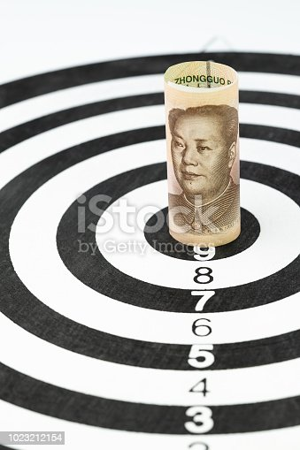928696036 istock photo China, major country world economy financial trade war tariff target concept, Chinese Yuan bank roll targeted at the center of black and white and number of score dartboard 1023212154