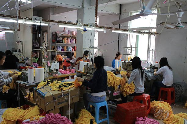 china manufacturing small factory - garment stock photos and pictures