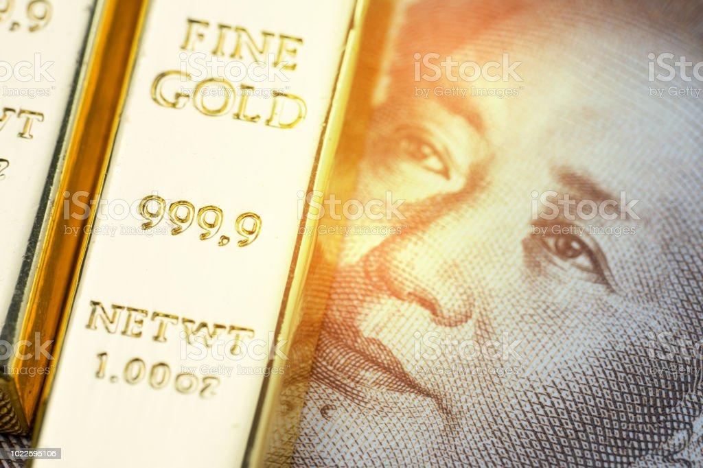 China national gold reserve concept, shiny gold bar bullion ingot on Chinese yuan banknote money with shiny golden flare light, country financial asset or safe haven investment in stock crisis stock photo