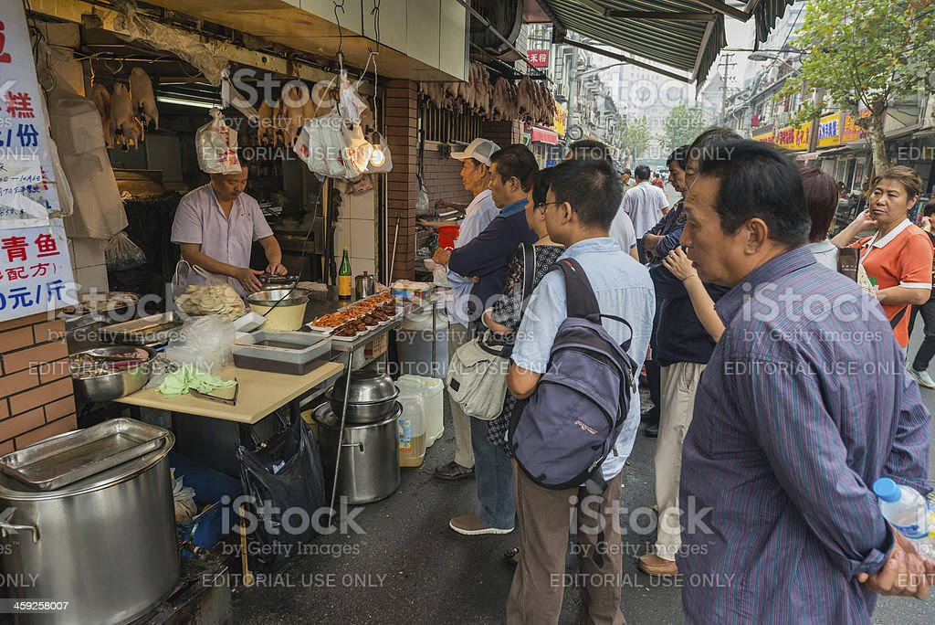 China people queuing at busy food stall Shanghai royalty-free stock photo