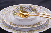 Limoges china. Gold spoon and fork.
