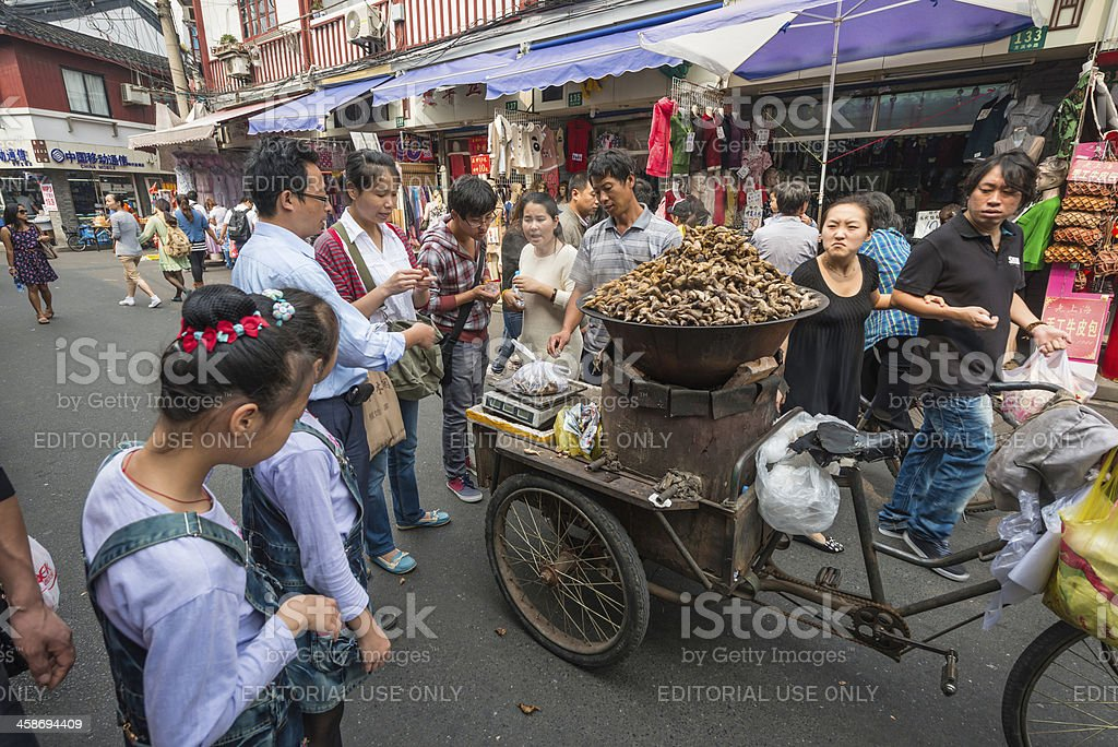 China street food seller in crowded market Shanghai stock photo