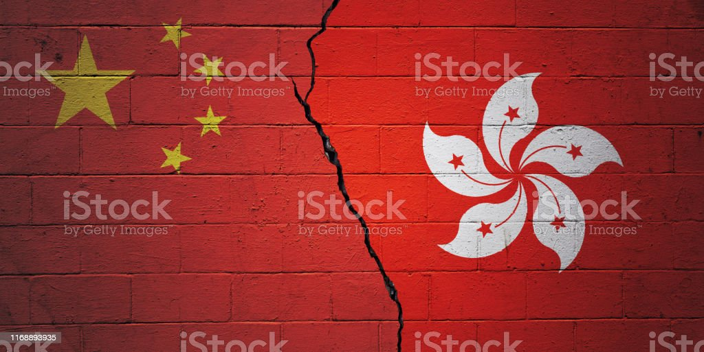 China vs Hong Kong Cracked brick wall painted with a Chinese flag on the left and a Hong Kongese flag on the right. Agreement Stock Photo
