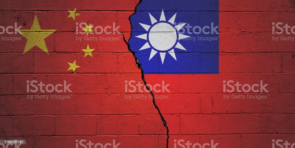 China vs Taiwan Cracked brick wall painted with an Chinese flag on the left and a Taiwanese flag on the right. Agreement Stock Photo
