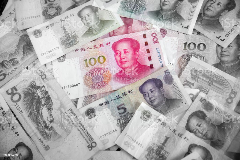 China yuan note a background.Pile of various currencies isolated on white background. stock photo