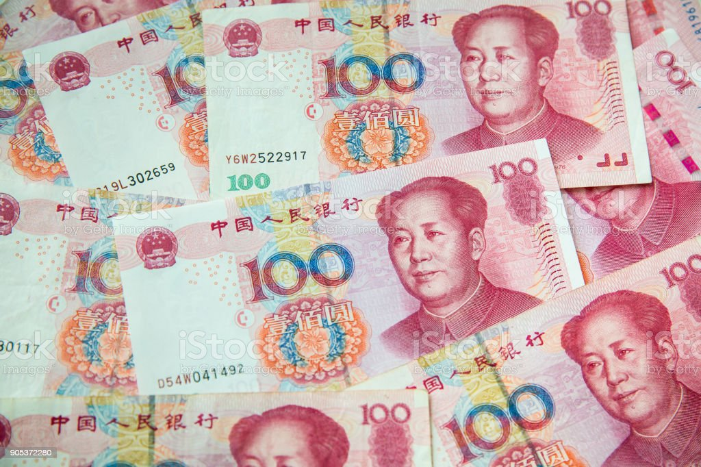 China yuan note a background.Pile of various currencies stock photo