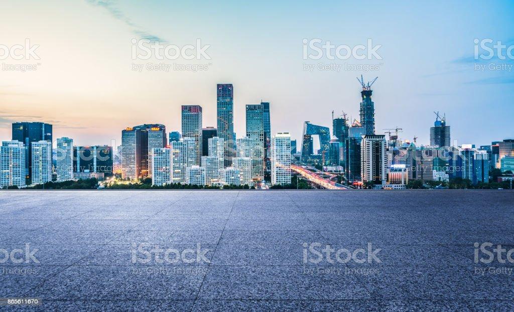 China,Beijing,2016/09/03,empty brick platform with Beijing skyline in background at twilight stock photo