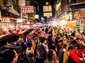 Crowd walking on Yaowarat Road Chinatown Bangkok. All the area is very popular at night because of the excellent street food