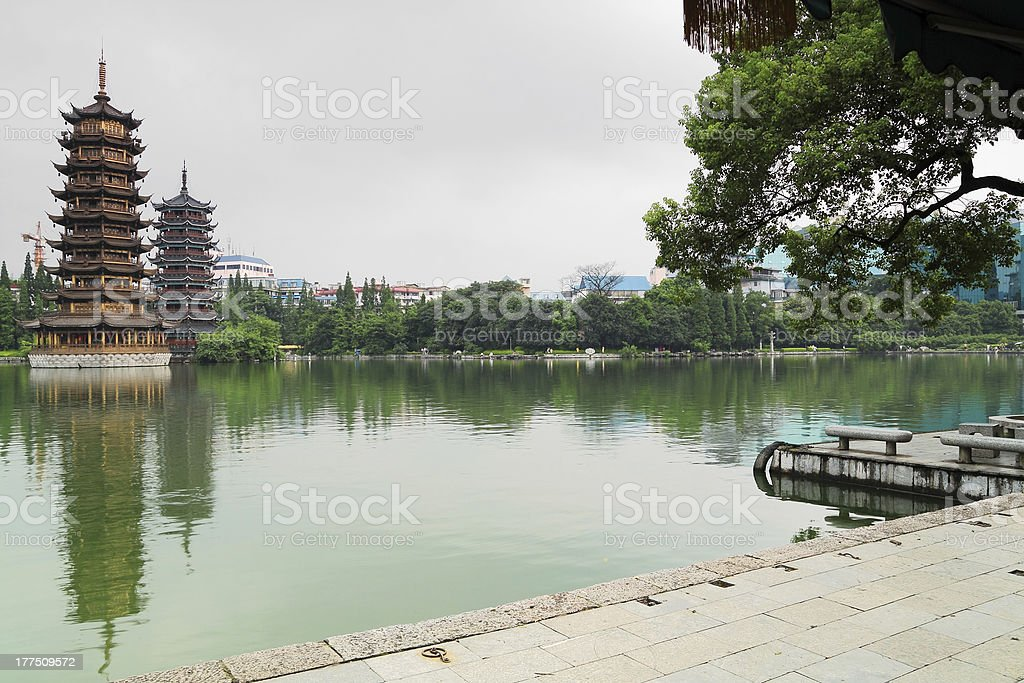 Chinese ancient pagodas in the river side stock photo