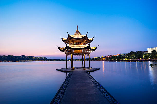 chinese ancient pavilion with sunset at the west lake - Photo