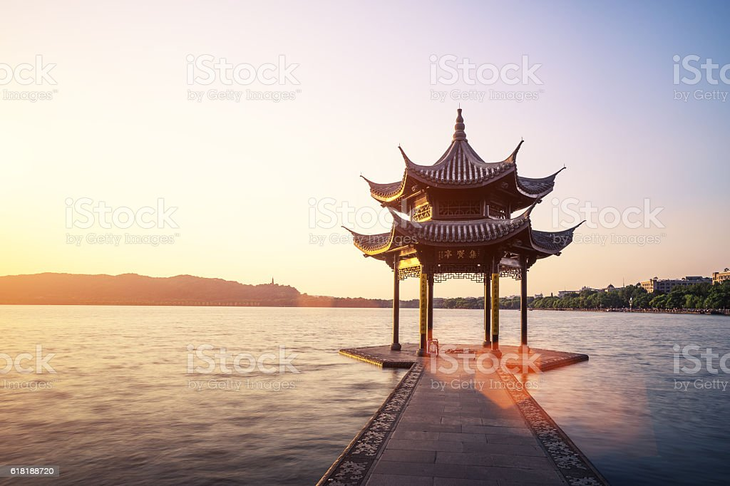 chinese ancient pavilion with sunset at the west lake stock photo