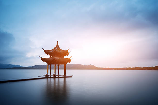 chinese ancient pavilion with sunset at the west lake chinese ancient pavilion with sunset at the west lake in hangzhou pagoda stock pictures, royalty-free photos & images