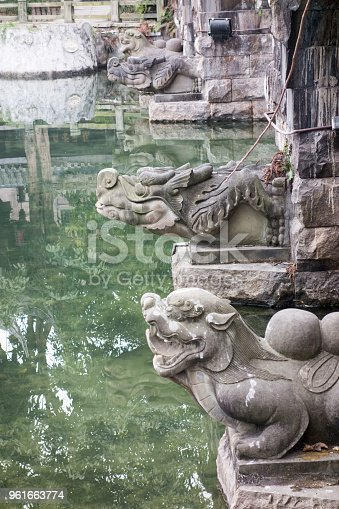chinese ancient sculpture under the bridge