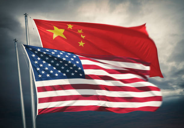 Chinese and US flag waving together stock photo