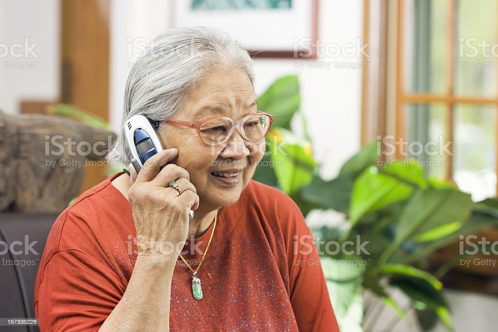 Chinese Asian Senior Woman Talking on Telephone, Holding Mobile Phone stock photo
