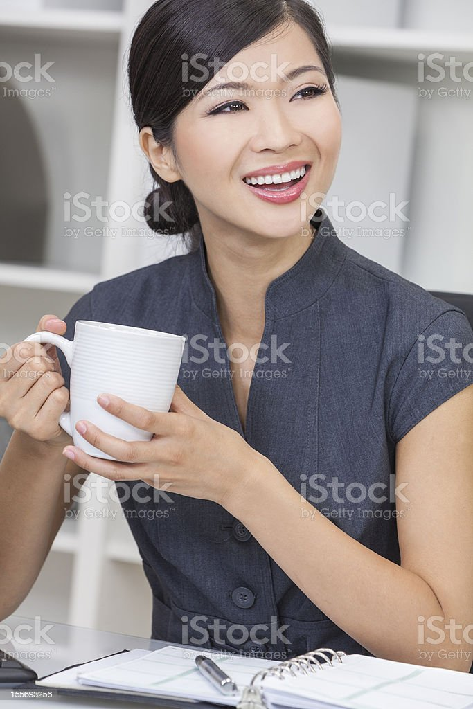 Chinese Asian Woman Businesswoman Drinking Tea or Coffee royalty-free stock photo