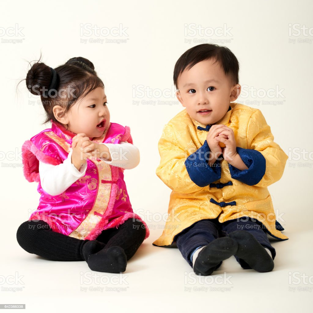 Chinese Baby Boy And Girl In Traditional Chinese New Year Outfit Stock Photo Download Image Now Istock