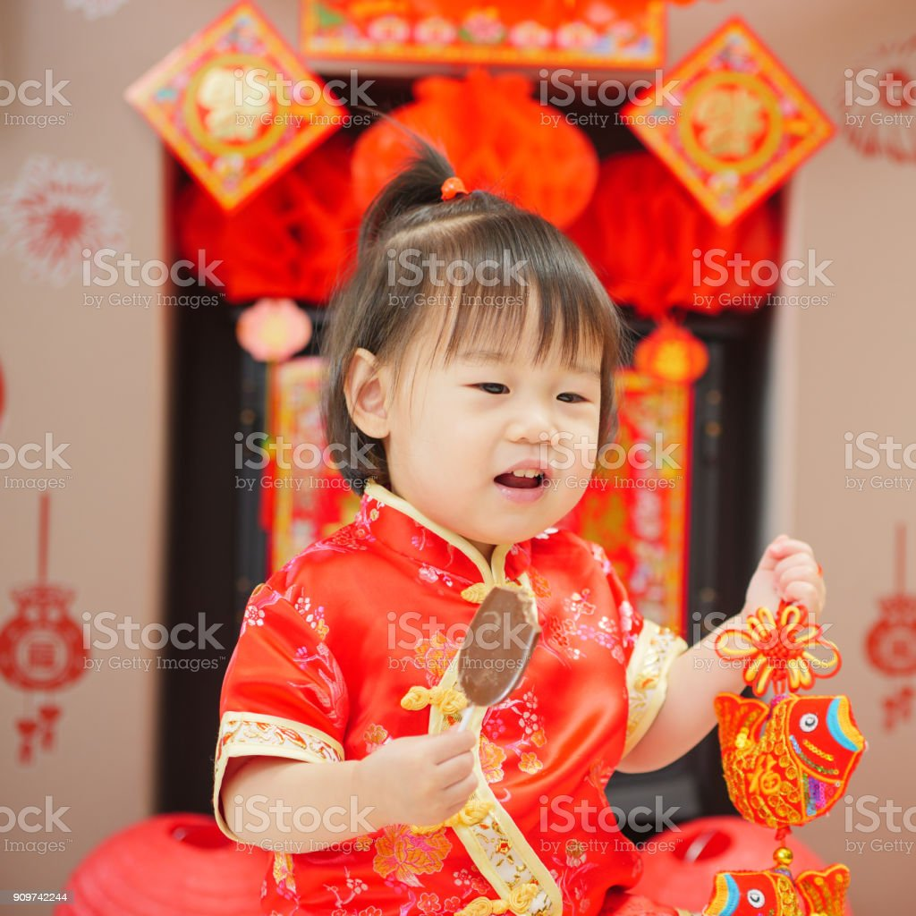 06925400d Chinese baby girl traditional dressing up celebrate Chinese new year royalty -free stock photo