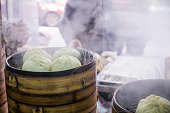 Chinese bamboo steamers steaming steamed bread and dumplings in breakfast shop