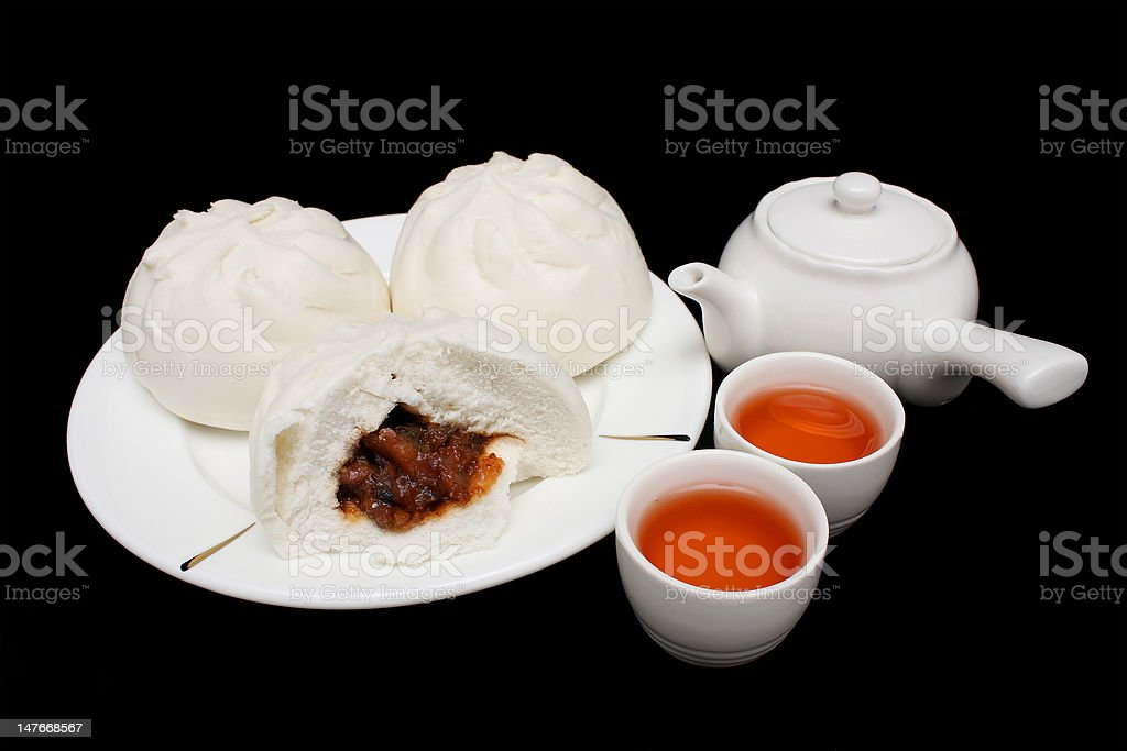 Chinese Barbecued Pork Bun with Teapot and Teacups royalty-free stock photo