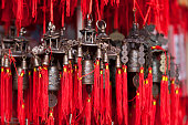 Close-up on Chinese bells for sale.