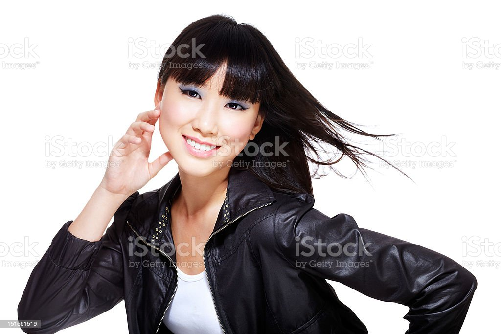 Chinese biker chick in black leather jacket and windswept hair stock photo