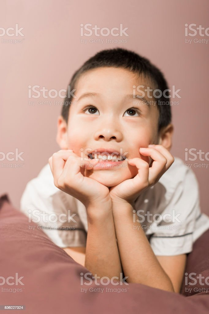 Chinese boy holding his chin stock photo
