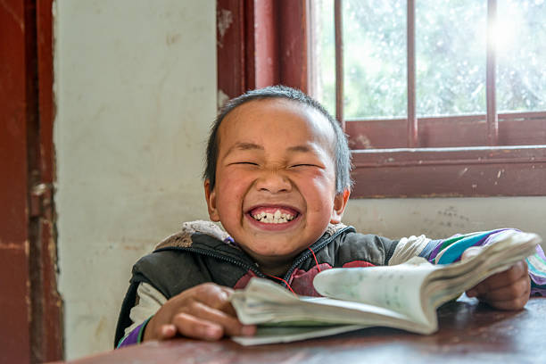 Chinese Boy with big smile at school,looking at camera stock photo