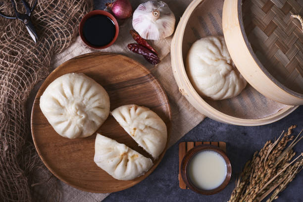 Chinese breakfast: Steamed buns (Baozi), fried breadsticks (yout stock photo