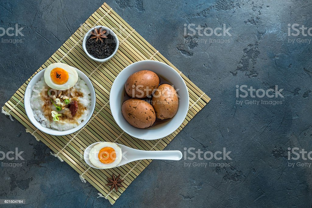 Chinese breakfast with rice porrige and tea eggs, place for foto stock royalty-free