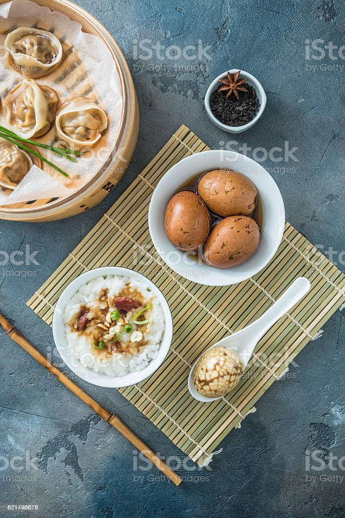 Chinese breakfast with rice porrige, tea eggs and dim sum foto stock royalty-free