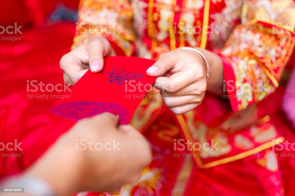 Chinese bride giving red pocket lucky money royalty-free stock photo