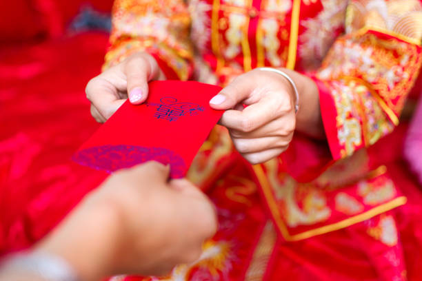 Chinese bride giving red pocket lucky money stock photo