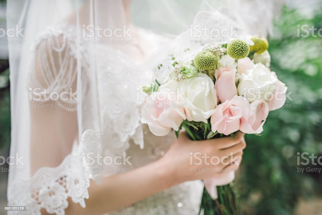 Chinese bride holding bouquet of white flowers stock photo more chinese bride holding bouquet of white flowers royalty free stock photo mightylinksfo