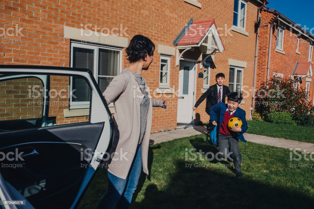 Chinese Brothers Rushing to School! stock photo