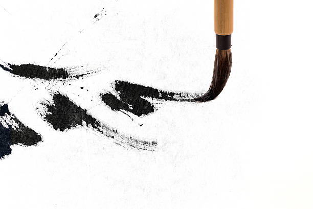 chinese brushes draw on white papers - calligraphy stock photos and pictures