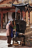 istock Chinese Buddhist monk-incense sticks-iron censer. Qianfo Grottoes section-Mati Si Temple-Zhangye-Gansu-China-0921 1249243836