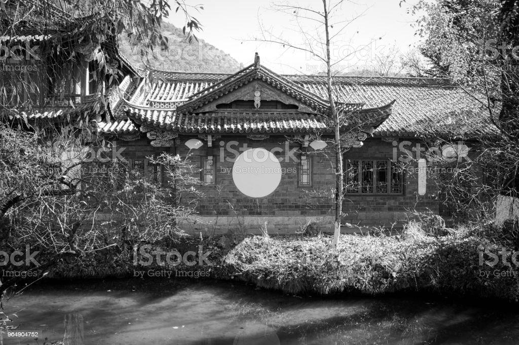 Chinese Building with a white circle (Lijiang, Yunnan, China) royalty-free stock photo