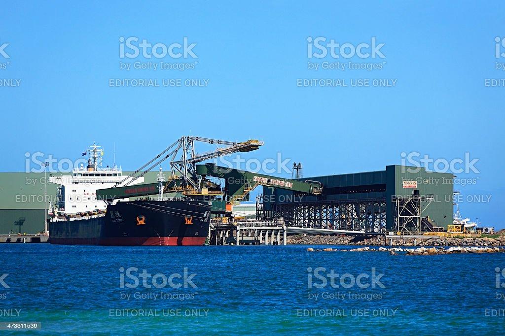 Chinese bulk carrier ship loading iron ore in Australian port stock photo