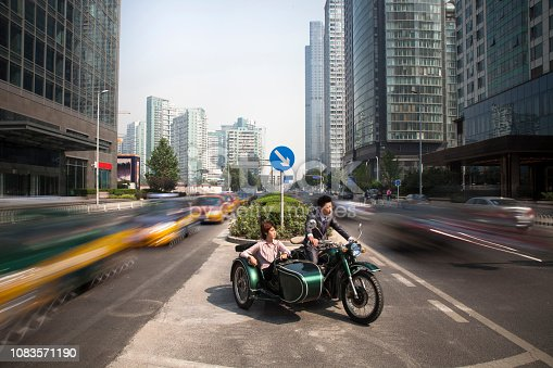 Chinese business people riding motorcycle with sidecar