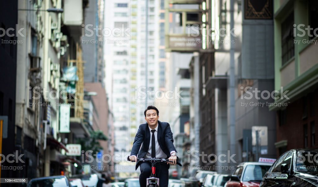 Chinese businessman commuting to work on a bicycle