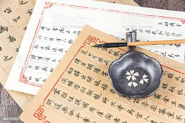Chinese Calligraphy and Chinese brush Chinese Calligraphy and Chinese brush Ancient Stock Photo