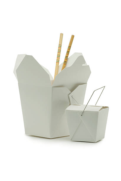 Chinese Carryout Food Containers Two sizes of asian-style carryout containers and a pair of chopstick shot on white in the studioClick on the banner below to see more photos like this. chinese takeout stock pictures, royalty-free photos & images