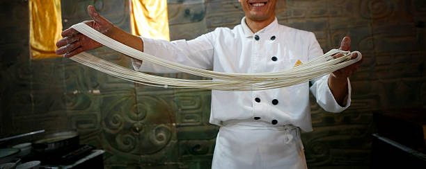 Chinese Chef with Handmade Noodles stock photo