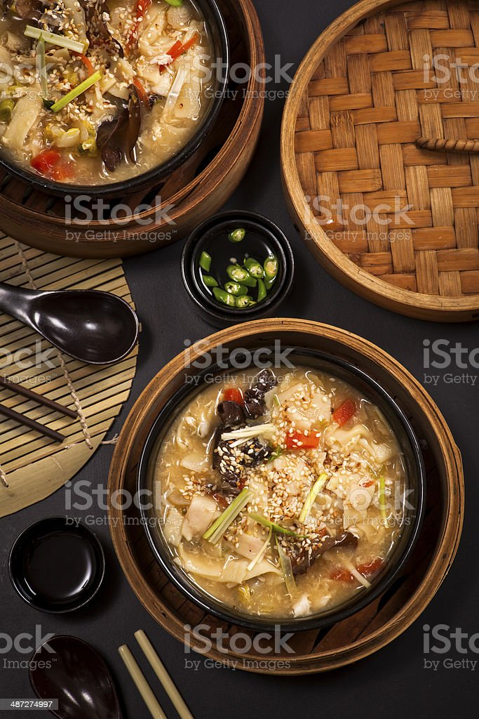 chinese chicken soup with noodles and mushrooms stock photo